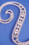swarovski (tm) crystals cover the front side of this vintage font sterling silver plated wedding cake topper