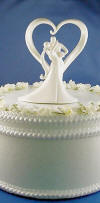 bride and groom in stylish embrace wedding cake topper figurine