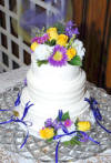 wedding reception charm cake - notice the charms are on purple ribbons around the bottom cake tier.