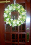 wedding wreath of flowers and fruit on entrance door