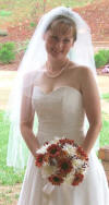 This bride is wearing a traditional strand of pearls for her wedding day.